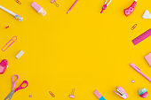 School stationery on a yellow background. Top view with copy space. Flat lay. Back to school concept.