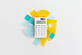 School rulers and calculator on grey background. Top view with copy space. Flat lay. Back to school concept.