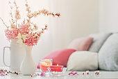 spring pink flowers in vase on white interior
