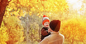 young father and little son in autumn park