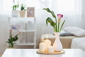 flowers in vase on white table indoor