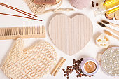 wooden heart and eco friendly hygiene products mock up top view