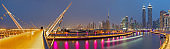 Dubai - The evening skyline with the bridge over the new Canal and Downtown.