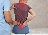 Woman suffering from neck and low back pain during medical exam. Chiropractic, , Physiotherapy. Posture correction