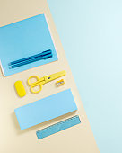 School stationery in yellow and blue tone. Office accessories study and educational flat lay.
