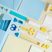 Layout of school supplies, notebooks, pens, pencils, medical mask and hand sanitizer Back to school concept