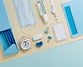 Stationary school supplies in yellow and blue tone. Office accessories and personal protective equipments