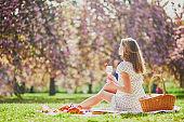 Beautiful young woman having picnic