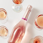 Rose wine assortment in crystal glasses, bottle of rose champagne sparkling wine. Summer alcoholic drink