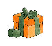 Orange gift box with a green bow and two Christmas balls