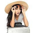 Young Asian women tourists wearing wide-brimmed straw hats and sunglasses. She expressed surprise and excited about travel promotion. Isolated on white background