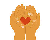 Human hands holding hearts