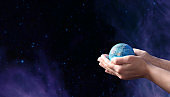 Earth day holiday concept.Close up image of human hands holding  planet earth against space background.Environment  concept.