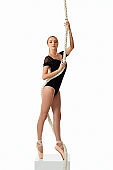 beautiful ballerina in pointe shoes is posing
