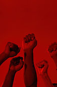 Hands of multiracial people clenched into fists