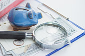 Clean insurance form, piggy bank, magnifying glass, notebook and money