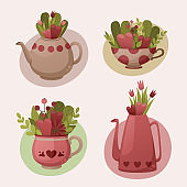 Beautiful collection of decorative teapots and cups with flowers