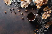 Acorn coffee in cozy autumn lifestyle on brown.
