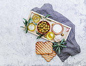 Flat lay Olive oil, olives and branch of olives on white background directly above. organic fresh olive oil.