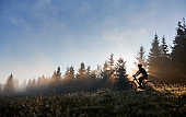 Male cyclist riding bicycle in the morning.