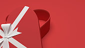 Empty heart shape gift box with white ribbon bow isolated on red pastel color background with shadow