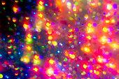 Colorful bokeh rainbow wallpaper. Neon defocused black overlay.