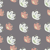 Pastel tones floral seamless pattern with simple hand drawn naive flower silhouettes. Blue pale background.