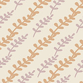 Pastel tones seamless nature pattern with pastel orange and purple leaf branches silhouettes. Doodle style.
