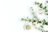 Eucalyptus essential oil, eucalyptus leaves on white background. Natural, Organic cosmetics products. Medicinal, Natural Serums. Flat lay, top view