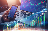 Business woman using  laptop computer with financial graphs and statistics.  Investment of growth on currency rate.
