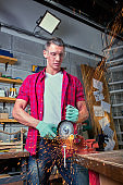 Locksmith cuts metal with a grinding machine, Mechanic power saw cuts