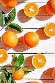 Fresh orange on white wooden