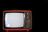 Vintage old TV close-up in a dark room.