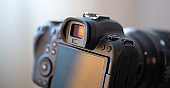 Close up part of a professional digital camera on a blurred background.