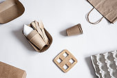 Still life with ecological disposable tableware made of bamboo wood and paper top view.