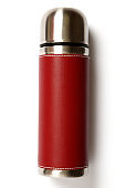 Stainless steel thermos with red leather cover isolated on white background.