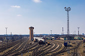 Vilnius region, railway station on a sunny day, transporting system with many crossing rails