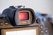 Close up viewfinder of a professional digital camera.