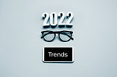 Looking for trends for 2022 concepts with text and smartphone.
