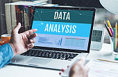 Data analysis  text on laptop with young businessman working.Business strategic planning.research information data
