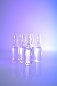 Medicine and Pharmacology.Biotechnology and Science.Glass transparent ampoules set in light purple tones.Ampoules with solution for injection