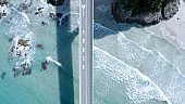 """White sand beach.""""Tsunoshima Bridge"""" in Yamaguchi Prefecture, Japan. A marine road bridge with a superb view. Taken with a drone on a sunny day. The road over the sea is very beautiful."""