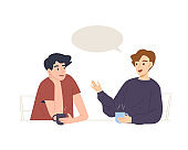 Two young male having a conversation at coffee time. Small talk at coffee shop or office.