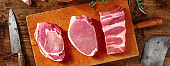 Pork meat panorama on a rustic wooden table