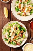 Caesar salad a dark rustic wooden table