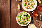 Caesar salad, shot from above on a dark rustic wooden background