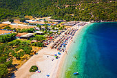 Beautiful crystal clear azure water at Antisamos beach on Kefalonia island, Greece. Beautiful sea bay with Antisamos beach on Kefalonia island, Ionian island, Cephalonia, Antisamos beach, Greece.