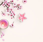 Cherry blossom, pink sakura spring flowers and candle
