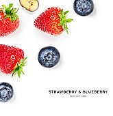 Strawberry and blueberry fruits creative composition