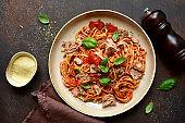Italian pasta spaghetti with tuna in tomato sauce